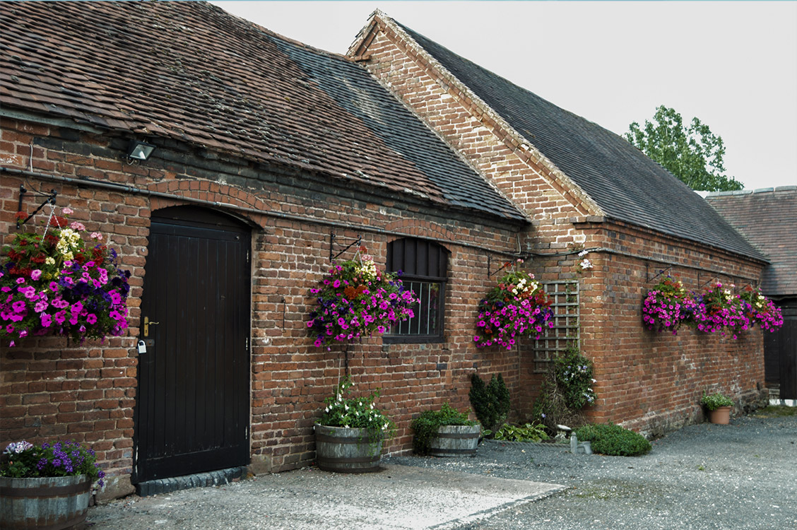 Enville Ales Brewery Exterior outdoors brick building beautiful hanging baskets
