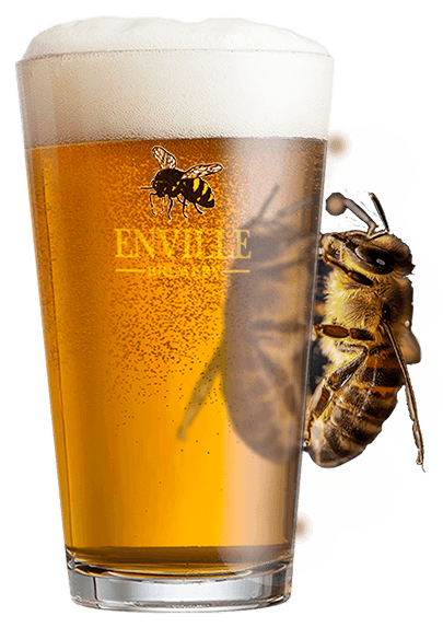 Enville Ale in pint glass with enville brewery logo and honey bee